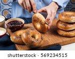 hands cutting fresh homemade... | Shutterstock . vector #569234515