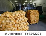Small photo of Bagged potatoes, prepared for transport and sale. Agribusiness, food industry technology and trade concept.