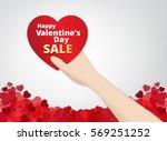 hand hold the heart label  on... | Shutterstock .eps vector #569251252
