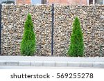 gabion wire mesh fence with... | Shutterstock . vector #569255278