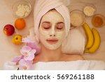 spa woman applying facial clay... | Shutterstock . vector #569261188