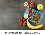 lunchbox with sandwich and... | Shutterstock . vector #569262442