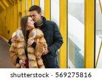 Guy Hugging A Girl In A Fur...