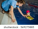 instructor teaches the child to ... | Shutterstock . vector #569275885