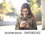 pretty girl having fun looking... | Shutterstock . vector #569283142