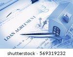 loan agreement on a clipboard ... | Shutterstock . vector #569319232
