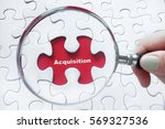 Small photo of Magnifying glass over jigsaw puzzle: Acquisition