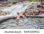 geothermal spa. mother and son... | Shutterstock . vector #569330902