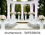 white pillars with bouquets of... | Shutterstock . vector #569338636