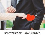 a man in a black suit with a... | Shutterstock . vector #569380396