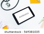slanted shot of doctors tablet... | Shutterstock . vector #569381035