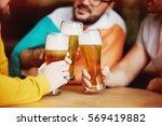 clinking beer glasses in irish... | Shutterstock . vector #569419882