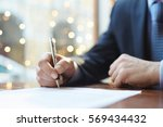 signing agreement | Shutterstock . vector #569434432