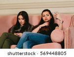 girls on the couch with... | Shutterstock . vector #569448805