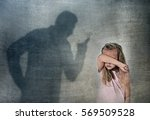 Stock photo father or teacher shadow screaming angry reproving misbehavior to young sweet little schoolgirl or 569509528