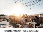 outdoor shot of young people... | Shutterstock . vector #569528032