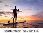 paddleboard on the beach at...   Shutterstock . vector #569534116