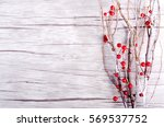 Branch With Berries On Wooden...