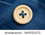 button on a polo t shirt fabric ... | Shutterstock . vector #569551372