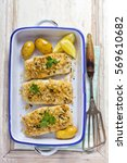 Small photo of Baked cod with breadcrumbs and herbs, served with baby potatoes
