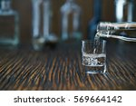 russian vodka pouring from the... | Shutterstock . vector #569664142