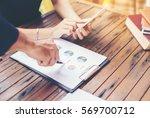 business team working on laptop ... | Shutterstock . vector #569700712