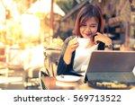 asian business girl working... | Shutterstock . vector #569713522