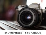 vintage film camera on wooden... | Shutterstock . vector #569728006