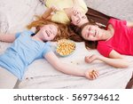 happy little girls  eating... | Shutterstock . vector #569734612