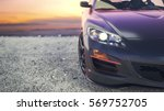 Stock photo close luxury cars as the sun sets behind the scenes 569752705