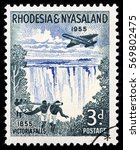 Small photo of LUGA, RUSSIA - SEPTEMBER 18, 2015: A stamp printed by RHODESIA AND NYASALAND shows beautiful view of Victoria falls - a waterfall in southern Africa on the Zambezi River, circa 1955
