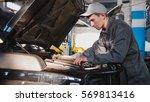 mechanic male in automobile... | Shutterstock . vector #569813416