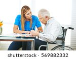 woman giving consultation to... | Shutterstock . vector #569882332