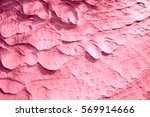 Small photo of Abstract image of pink sandy surface eluted with water