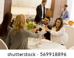 friends sitting at a dining...   Shutterstock . vector #569918896