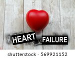 Small photo of Word HEART FAILURE and heart-shape symbol. Conceptual.