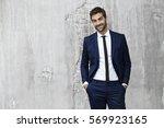 man in suit looking sharp ... | Shutterstock . vector #569923165