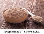 wheat bran in wooden bowl on a... | Shutterstock . vector #569955658