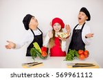 three young chefs evaluate a... | Shutterstock . vector #569961112