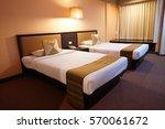interior of a hotel bedroom | Shutterstock . vector #570061672