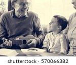 ukelele child grandparent... | Shutterstock . vector #570066382
