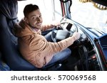 Driver In Cabin Of Big Modern...