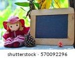 girly dollyl wearing red dress... | Shutterstock . vector #570092296
