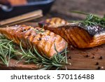 Stock photo grilled salmon fillets with salt pepper and herb decoration 570116488