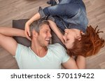 new home couple laughing... | Shutterstock . vector #570119422