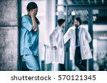 stressed nurse standing against ... | Shutterstock . vector #570121345