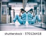 stressed nurse sitting in... | Shutterstock . vector #570126418