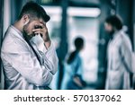 side view of a stressed doctor... | Shutterstock . vector #570137062