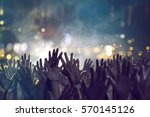 hands in the air | Shutterstock . vector #570145126