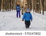 Kid Running In A Winter Park...